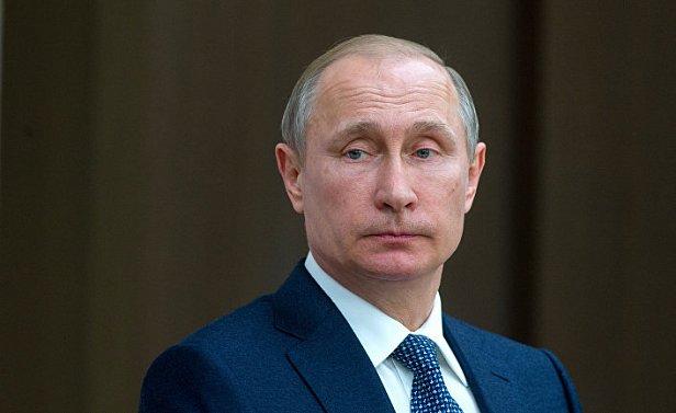 На фото  — Владимир Путин