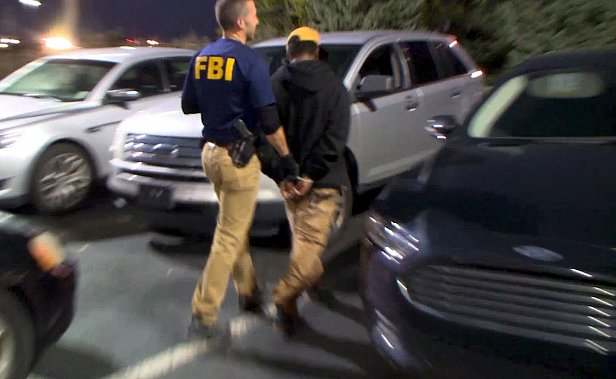Фото — В США арестовали украинского программиста