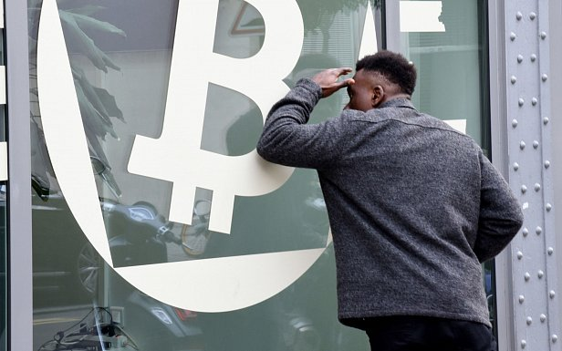 Фото — Значок Bitcoin