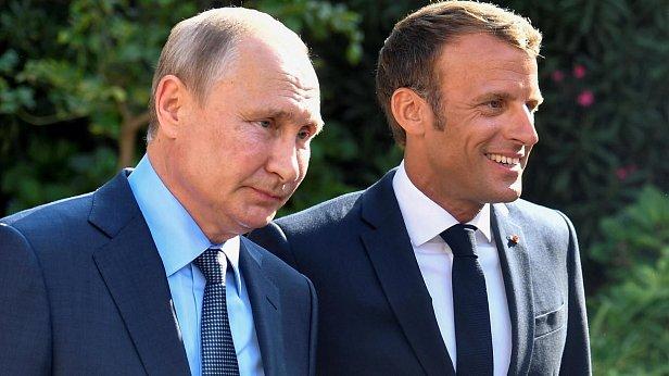 Фото — Эммануэль Макрон и Владимир Путин