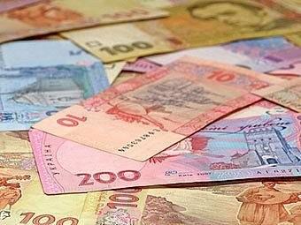 Гривня на межбанке закрылась курсом 23,05 за доллар